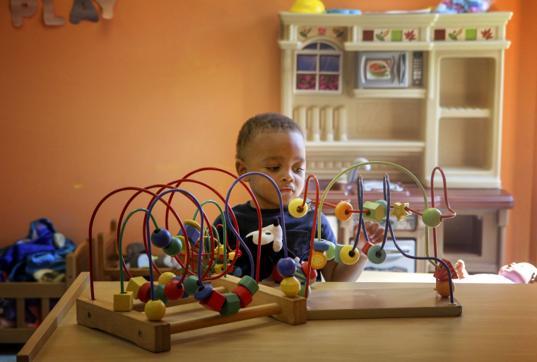 Image: A toddler plays at Uni-Pres Kindercottage in East St. Louis.