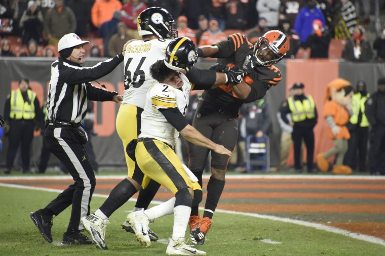 Quarterback Mason Rudolph #2 of the Pittsburgh Steelers fights with defensive end Myles Garrett #95 of the Cleveland Browns during the second half at FirstEnergy Stadium on November 14, 2019 in Cleveland, Ohio. The Browns defeated the Steelers 21-7.