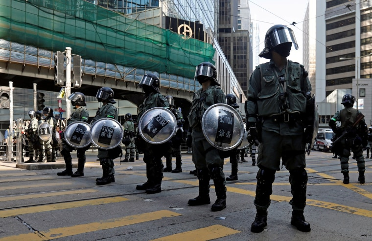 Image: Riot police stand in the middle of a street in Central district in Hong Kong, China