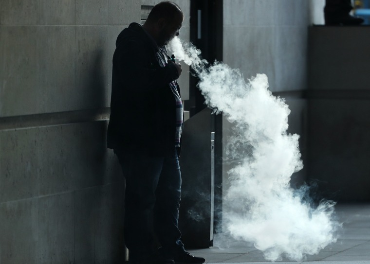 Image: A vapor cloud produced by a man with an e-cigarette in London.