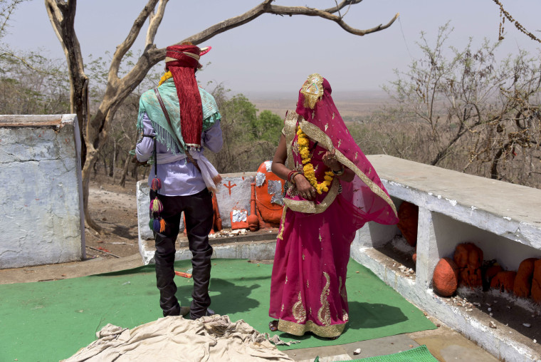 A fourteen-year-old child bride performs rituals with the groom after getting married at a Hindu temple near Rajgarh, in India's Madhya Pradesh state in 2017.