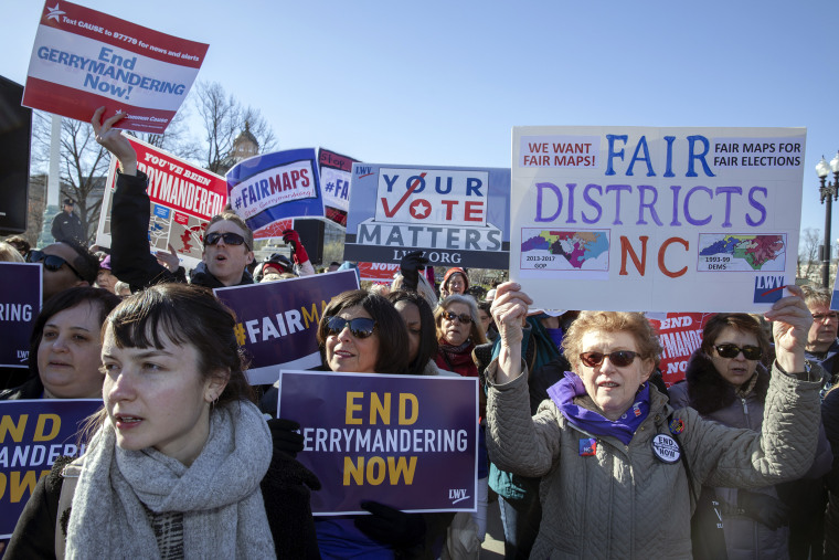 """Image: Protesters attend a rally for \""""Fair Maps\"""" on March 26, 2019 in Washington."""