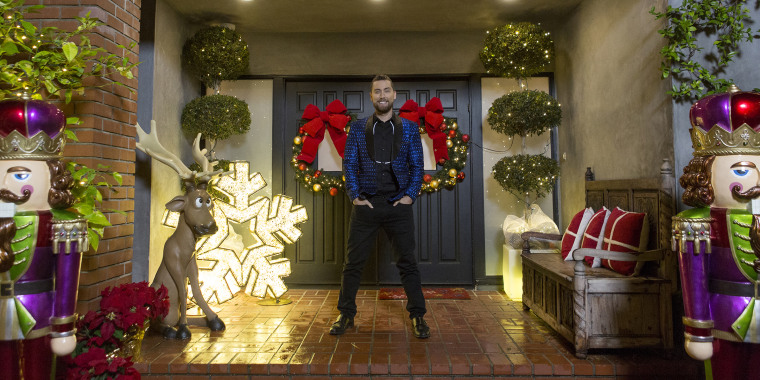 "Bass showcases his own home and holiday decorating style while hosting HGTV's ""Outrageous Holiday Houses."""