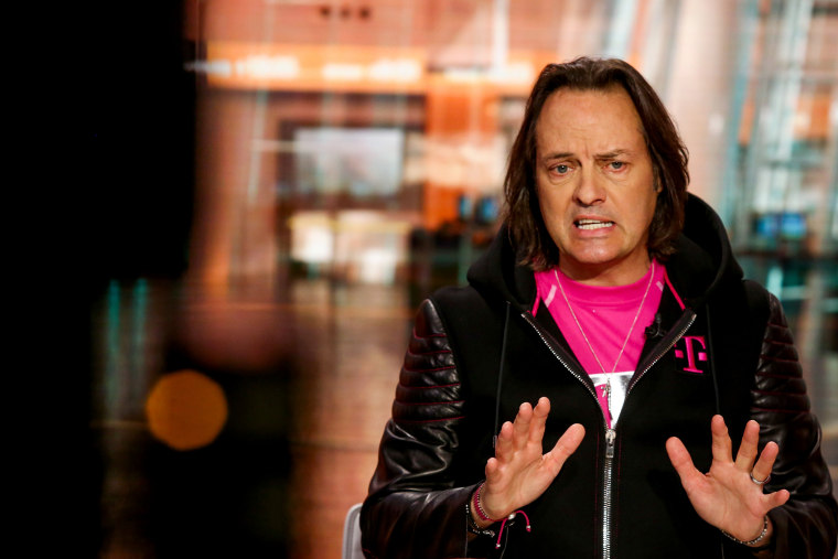 Image: T-Mobile CEO John Leger speaks during an interview in New York on April 26, 2018.
