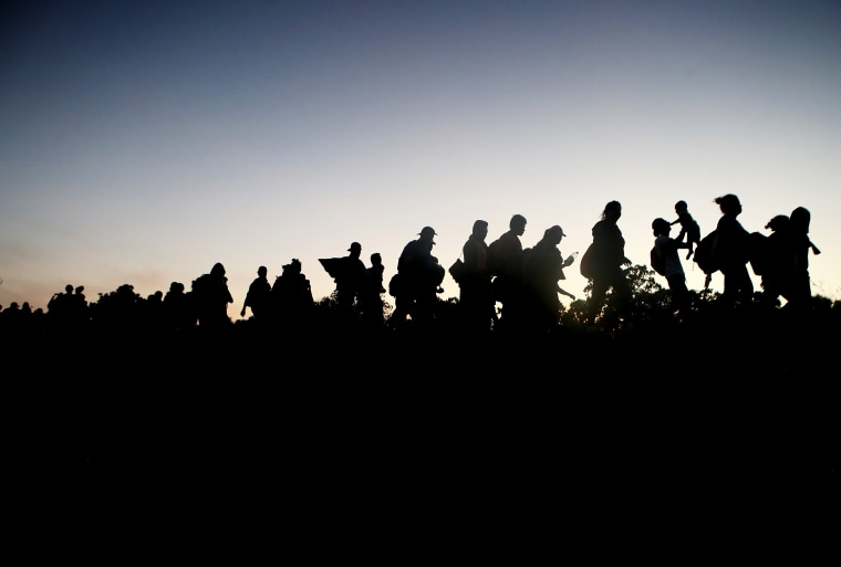 Image: A migrant caravan walks towards the United States in Tapanatepec, Mexico, on Jan. 21, 2019.