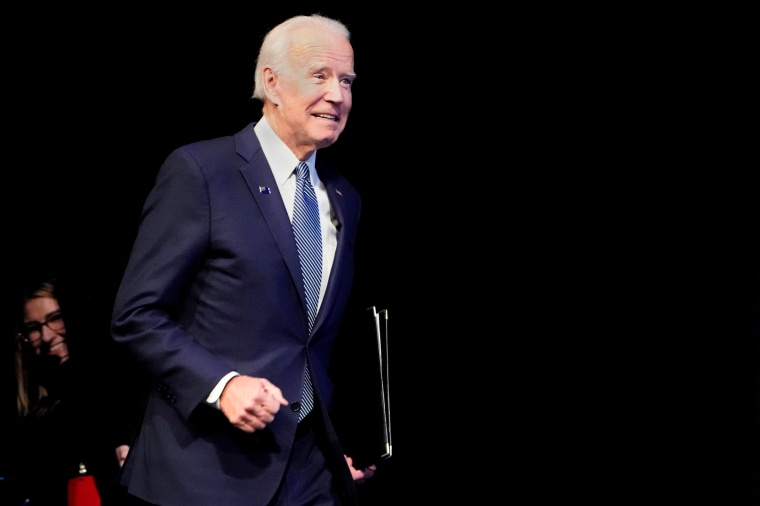 Image: Joe Biden runs on stage at a First in the West Event at the Bellagio Hotel in Las Vegas