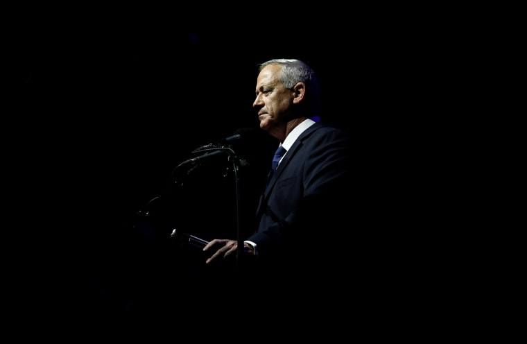 Image: Benny Gantz, head of Blue and White party, speaks during a rally commemorating the 24th anniversary of the assassination of Israeli Prime Minister Yitzhak Rabin, in Tel Aviv,