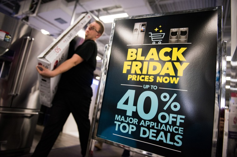 Image: An advertisement for Black Friday sales on appliances stands on display at a Best Buy Inc. store in Paramus, New Jersey.