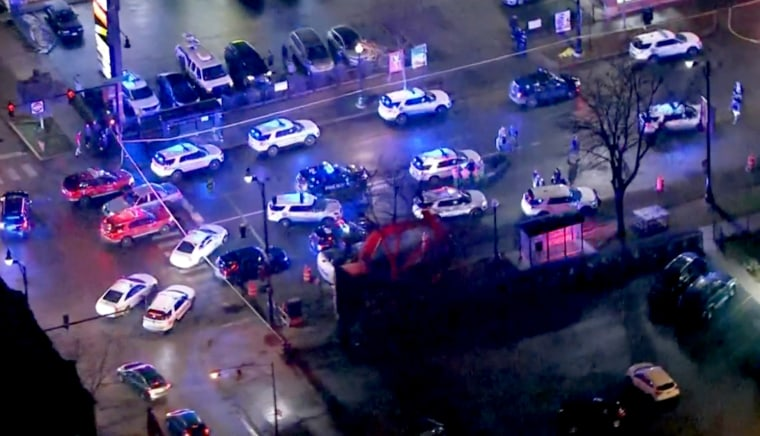 Image: A Chicago police officer and two other individuals are in critical condition after a gun battle in the city's Old Irving Park neighborhood Tuesday night.
