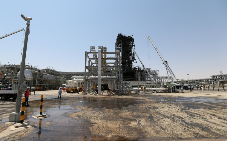 Image: Workers are seen at the damaged site of Saudi Aramco oil facility in Khurais on Sept. 20.