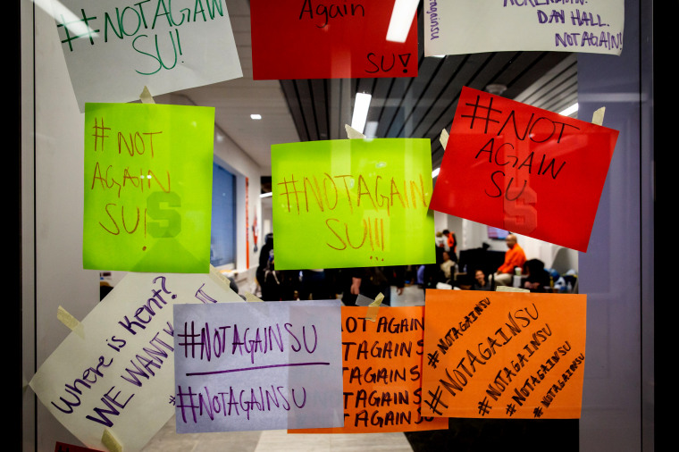 Image: Signs at a student sit-in after a series of racist incidents on campus at Syracuse University in New York on Nov. 20, 2019.