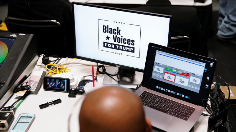 Image: U.S. President Donald Trump is seen broadcasted live on a phone as he speaks at his Black Voices for Trump Coalition rollout event in Atlanta