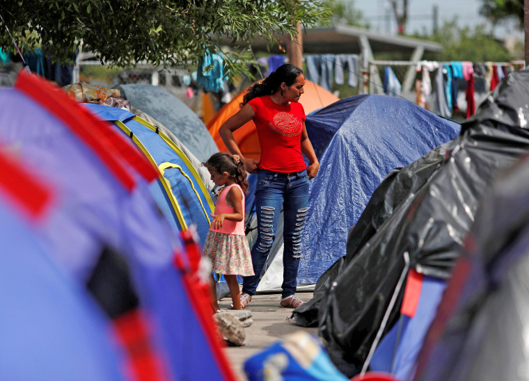 Image: FILE PHOTO: Central American migrants are seen outside their tents in an encampment in Matamoros