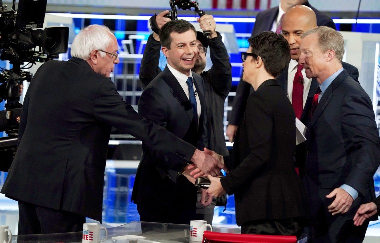 Image: Democratic presidential candidates Sanders, Buttigieg, Booker and Steyer all thank moderator and MSNBC host Rachel Maddow after the conclusion of the U.S. Democratic presidential candidates debate at the Tyler Perry Studios in Atlanta