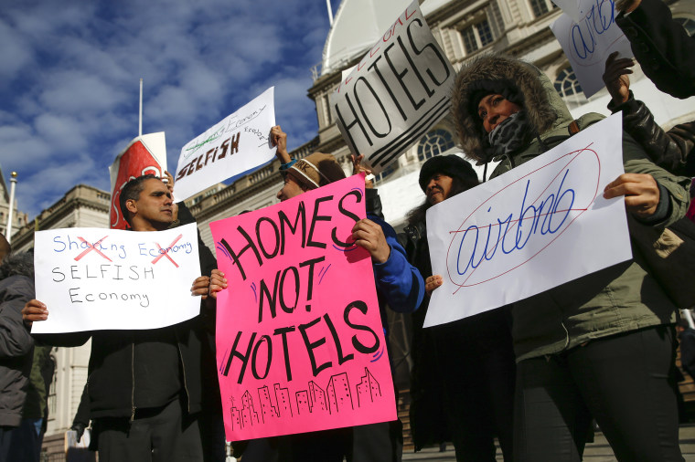 "Opponents of Airbnb rally before a hearing called ""Short Term Rentals: Stimulating the Economy or Destabilizing Neighborhoods?"" at City Hall in New York"