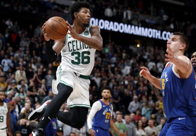 Image: Boston Celtics guard Marcus Smart pulls a rebound against the Denver Nuggets on Nov. 22, 2019.