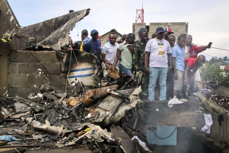 Image: Rescuers and residents gather near debris of a small plane after it crashed in Congo's eastern city of Goma on Nov. 24, 2019.