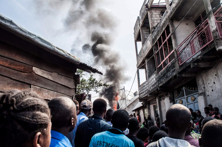 Image: Smoke rises from the scene after a small plane crashed in Goma, a city in the Democratic Republic of Congo, on Nov. 24, 2019.