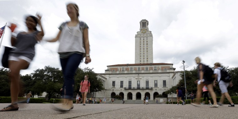 Students walk through the University of Texas at Austin campus near the school's iconic tower in 2012.
