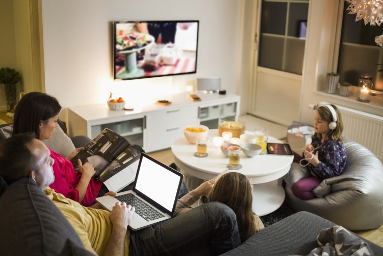 Image: Family using technologies in living room