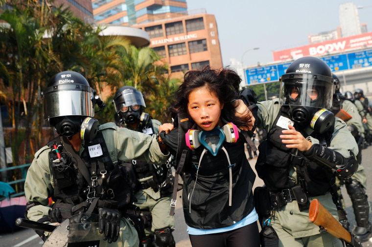 Image: A protester is detained by riot police while attempting to leave the campus of Hong Kong Polytechnic University (PolyU) during clashes with police in Hong Kong