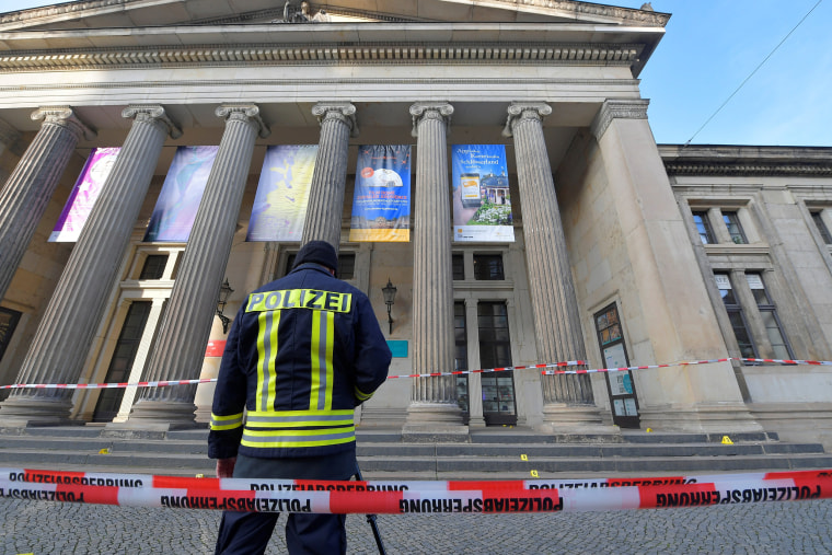 Image: A policeaman stands outside Green Vault city palace after a robery in Dresden