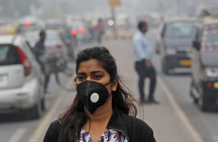 A commuter walks through thick smog in New Delhi on Nov. 14, 2019.
