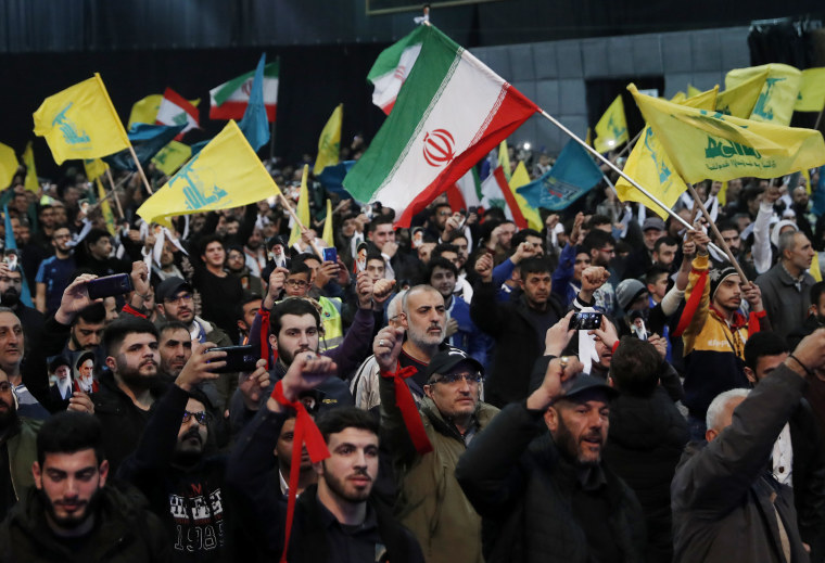 Hezbollah supporters shout slogans and wave Lebanese, Hezbollah and Iran flags during a rally to commemorate the 40th anniversary of Iran's Islamic Revolution in southern Beirut on Feb. 6, 2019.