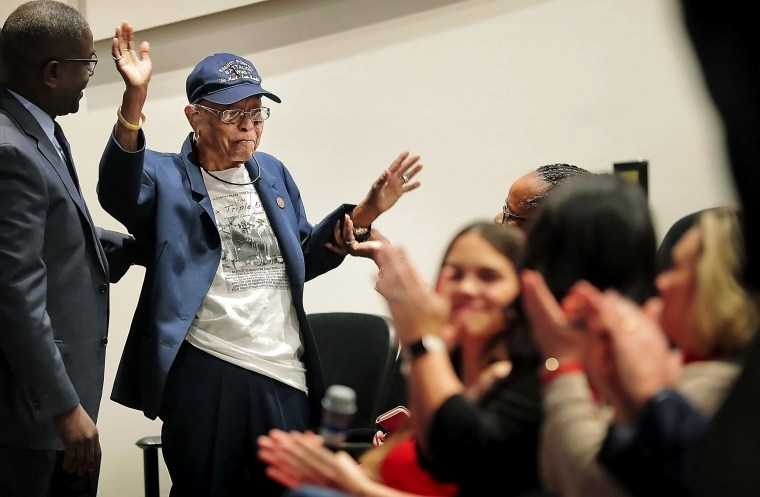 Image: Indiana Hunt-Martin, a member of the only all-female, all-African American unit to be deployed by the U.S. in World War II, gets a standing ovation from employees at a FedEx Veterans Day program in Memphis on Nov. 8, 2019.