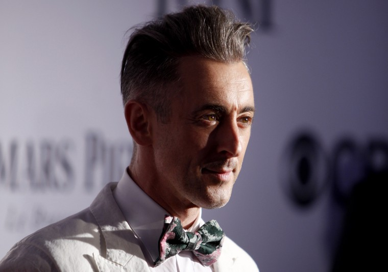 Image: Alan Cumming arrives to the Tony Awards in New York in 2013.