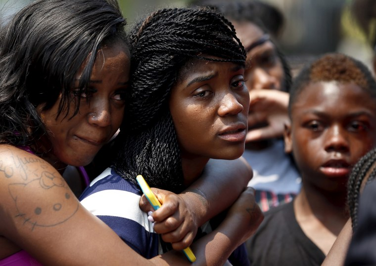 Mourners grieve for 7-year-old Amari Brown who was shot and killed in Chicago on July 5, 2015.