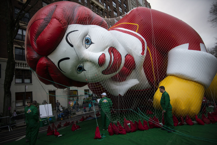 Image: The Ronald McDonald balloon is kept under a net during the inflation process