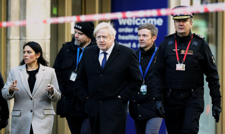 Image: British Prime Minister Boris Johnson arrives to the scene of a stabbing that left two people dead in London on Nov. 30, 2019.