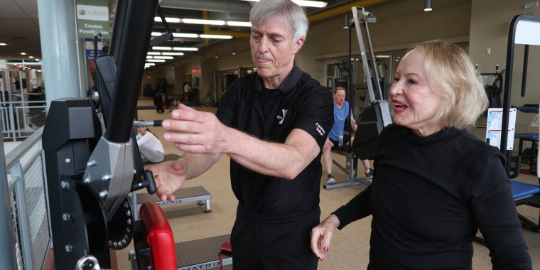 Ruth Kundsin, 103, works out with her personal trainer Dick Raymond at the South Shore YMCA in Quincy, Massachusetts.