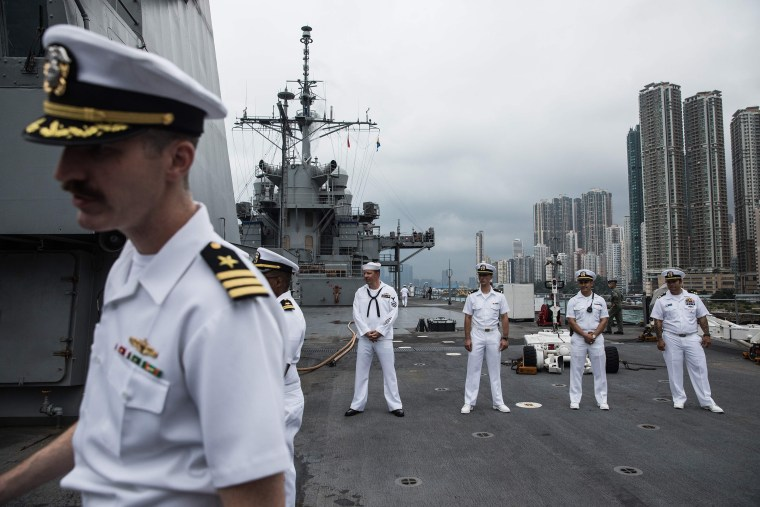 Image: Crew members standing on the deck of the USS Blue Ridge during a port call in Hong Kong
