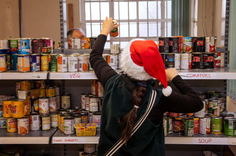 Image: A volunteer collects food at the Trussell Trust Food Bank in Liverpool, England, on Dec. 21, 2015.
