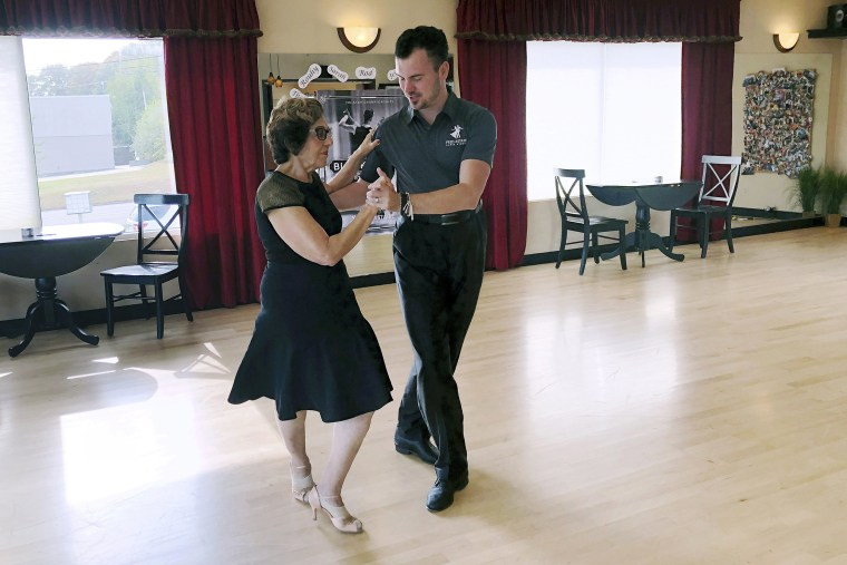 Image: Dance instructor Ned Pavlovic teaches Rouhy Yazdani to ballroom dance at the Fred Astaire dance studio in Orange, Conn., on Oct. 7, 2019.