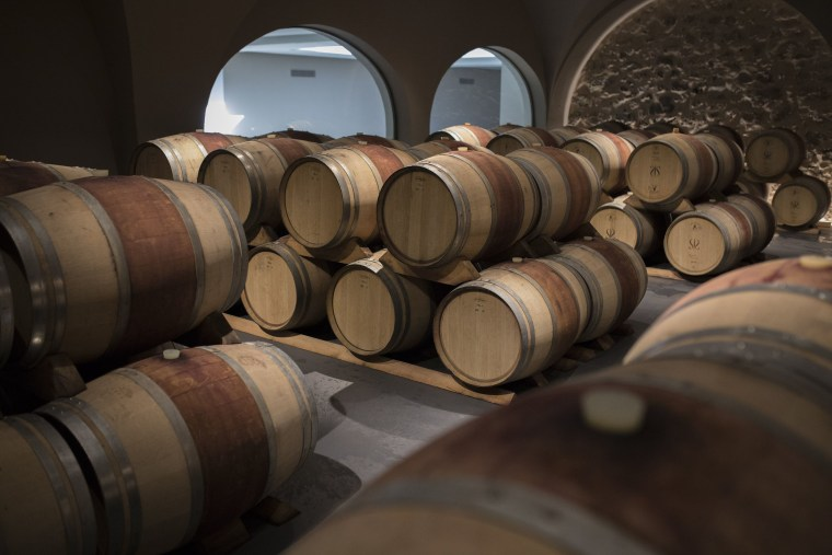 Image: Wine barrels sit in a wine cellar in the southern French region of Provence