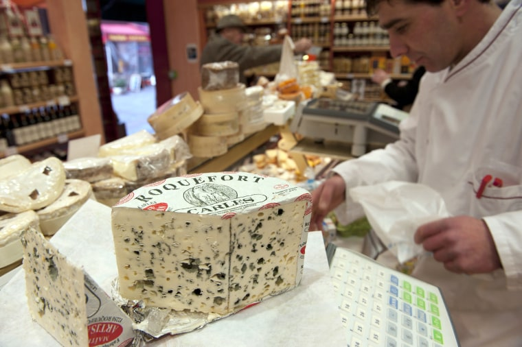 Image: A piece of French Roquefort blue cheese is displayed in a shop in Paris