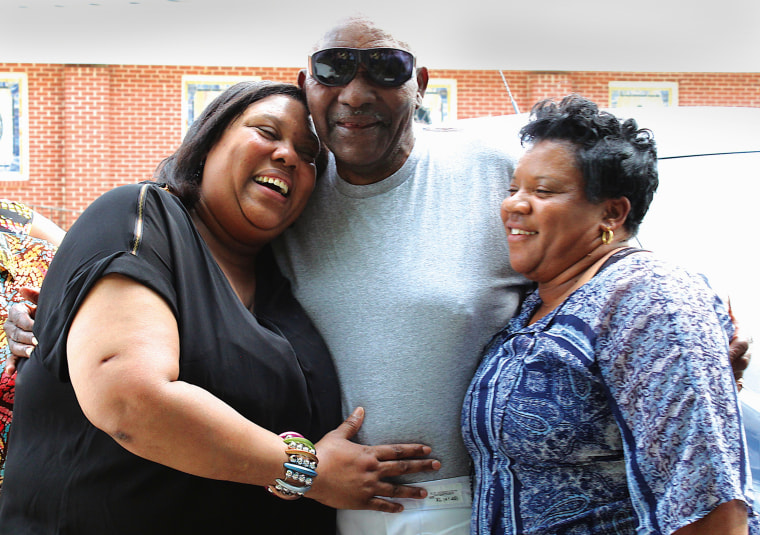 Charles Ray Finch receives hugs from his two daughters, Katherine Jones-Bailey, left, and Christina Sauls-Shelley, in the Maury Chapel Free Will Baptist Church parking lot after being released from the Greene Correctional Institution, on May 23, 2019 in Maury, N.C.