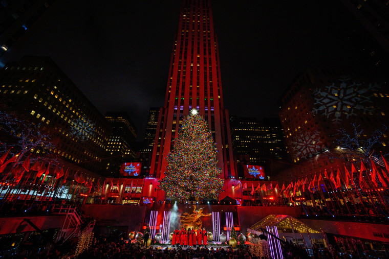 The Rockefeller Center Christmas tree was officially turned on Wednesday night, Dec. 4, at an event featuring celebrity performers.