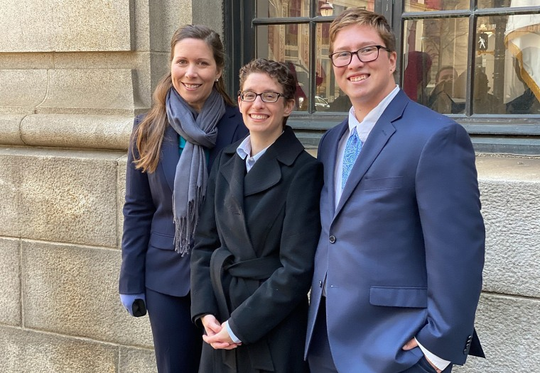 Plaintiff Drew Adams, right, with his mother, Erica Kasper, and a Lambda Legal lawyer outside the 11th U.S. Circuit Court of Appeals after oral arguments.