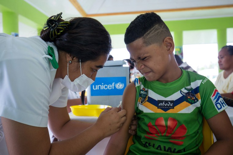 Image: A boy receiving a vaccine during a nationwide campaign against measles in the Samoan town of Le'auva'a