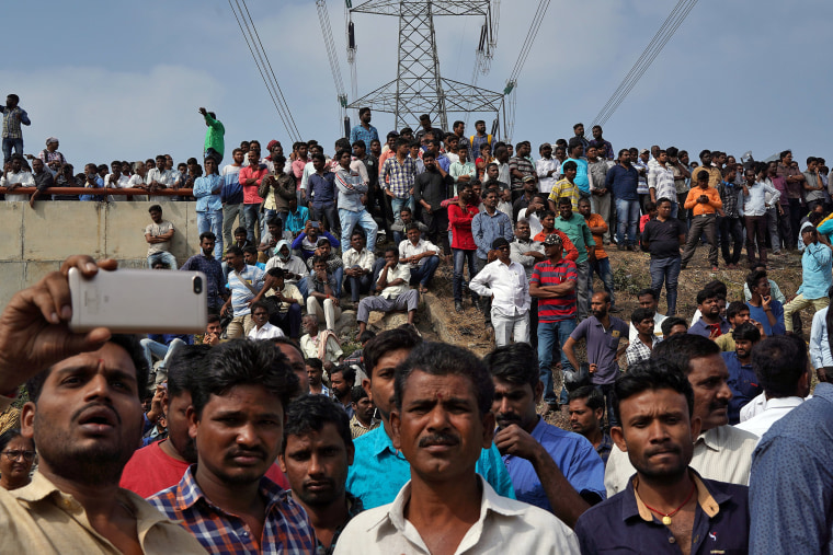 Image: People gather at the site where police shot dead four men suspected of raping and killing a 27-year-old veterinarian, in Chatanpally on the outskirts of Shadnagar town, Telangana, India