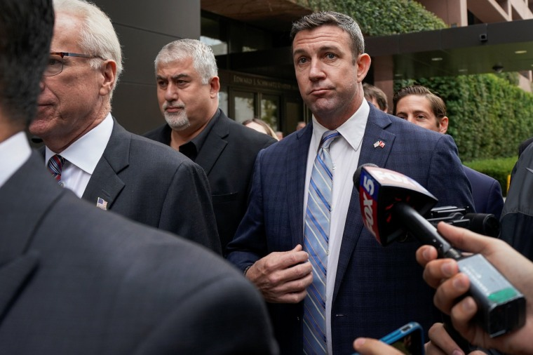 Image: U.S. Representative Duncan Hunter leaves federal court after pleading guilty to misusing campaign funds in San Diego