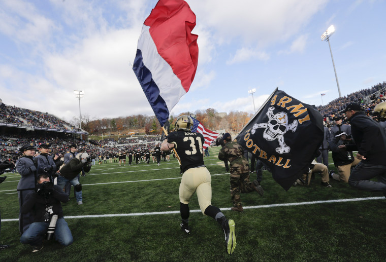 Army football team removes slogan because of ties to white supremacist groups