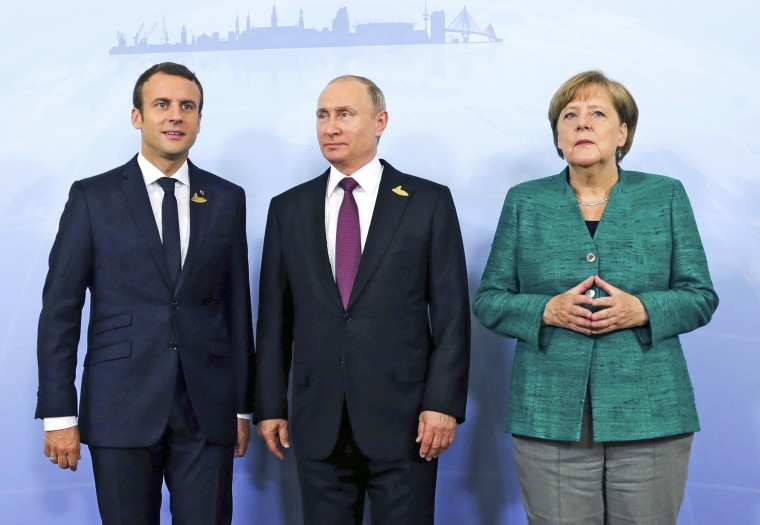 From left, French President Emmanuel Macron, Russia's President Vladimir Putin and German Chancellor Angela Merkel prior to a meeting during the G20 summit on July 8, 2017.