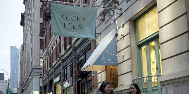 Pedestrians walk past the Lucky Lee's restaurant in the Greenwich Village neighborhood of New York on April 11, 2019.