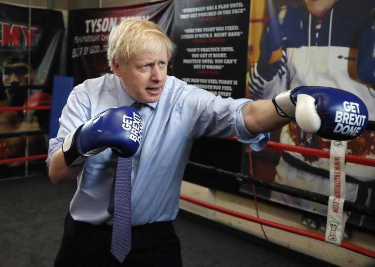 Image: Britain's Prime Minister Boris Johnson poses for a photo wearing boxing gloves during a stop in his General Election Campaign trail at Jimmy Egan's Boxing Academy in Manchester,