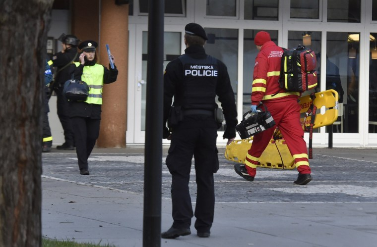 Image: Police personnel and paramedics outside the Ostrava Teaching Hospital after a shooting incident in Ostava, Czech Republic,
